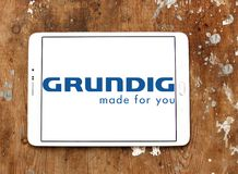 Grundig company logo. Logo of Grundig company on samsung tablet on wooden background. Grundig is a German manufacturer of consumer electronics, domestic royalty free stock photo