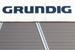Grundig logo on a wall. Dortmund, Germany - July 21, 2017: Grundig logo on a wall. Grundig is a German manufacturer of consumer electronics, domestic appliances royalty free stock image
