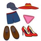 Grundlegende Mann- und Frauenkleidung Auch im corel abgehobenen Betrag Stockfoto