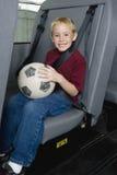 Grundlegender Student On School Bus Lizenzfreies Stockfoto