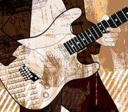 grunge背景的吉他演奏员 免版税库存照片