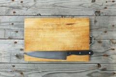 Grunge ножа разделочной доски Стоковое фото RF
