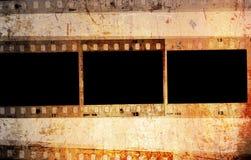 Grunge 35mm photo frames. Retro 35mm film frames over a grunge vintage paper background royalty free stock photography