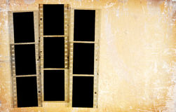 Grunge 35mm photo frames. Retro 35mm film frames over an abstract grunge background royalty free stock photography