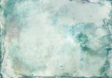 Grunge abstract background of watercolor paint blurred green color on paper with texture, in middle of an empty space for text. Grunge abstract background of Stock Image