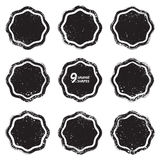 Grunge abstract textured vector badges. Set of 9 grunge abstract textured vector badges.  Vector design elements. Vector abstract background. Vector abstract Stock Images