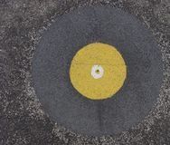 Grunge abstract white and yellow circle on asphalt Stock Images