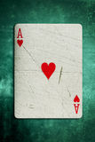 Grunge Ace card. A grunge Ace playing card on a textured green felt background Royalty Free Stock Images