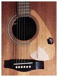 Grunge Acoustic Guitar. My old friend ,sound pretty old , used to write song Stock Photo