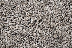 Grunge aged gravel ground surface texture in poor condition royalty free stock photo