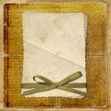 Grunge alienated card from old paper. On the abstract background Stock Photo
