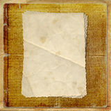 Grunge alienated card from old paper. On the abstract background Royalty Free Stock Image