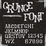 Grunge alphabet letters and numbers. Vector Royalty Free Stock Photography