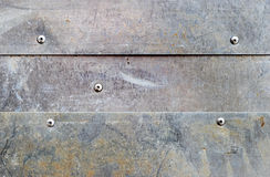 Grunge aluminium background. Banded grunge dirty aluminium background with rivets Royalty Free Stock Images