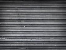 Grunge żaluzi miastowy rolkowy drzwi - Akcyjny wizerunek obraz royalty free
