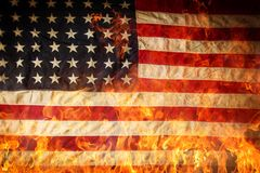 Grunge American flag, war concept. With fire flames, close-up Royalty Free Stock Images