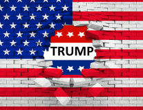 Grunge American USA flag, broken crack wall with hole and word trump Stock Photography