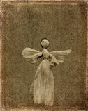 Grunge angel background. Abstract angel puppet on grunge background Stock Photos