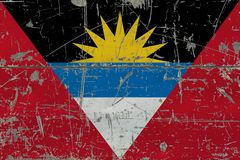 Grunge Antigua and Barbuda flag on old scratched wooden surface. National vintage background.  royalty free stock images