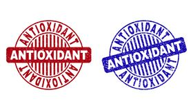Grunge ANTIOXIDANT Textured Round Watermarks. Grunge ANTIOXIDANT round stamp seals isolated on a white background. Round seals with distress texture in red and vector illustration