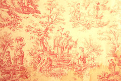 Grunge Antique Toile. Old, stained red and yellow figurative Frech toile fabric stock photos