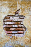 Grunge apple logo. Apple Inc. logo on grunge, weathered brick wall. Apple is an American multinational corporation is the maker Mac computers, iPod, iTune Royalty Free Stock Images