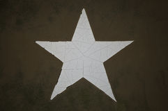 Grunge Army Star. Weathered star from an army tank Stock Photography