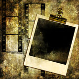 Grunge art. Grunge background with film strips and instant frame Stock Photography