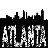 Grunge Atlanta text with skyline Stock Images