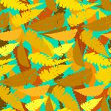Grunge autumn pattern with fern leafs. Vector seamless pattern with leafs inspired by fall nature and plants like palm trees and ferns in multiple yellow colors Royalty Free Stock Images