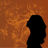 Grunge background. Orange swirly grunge background with a woman's silhouette Royalty Free Stock Photo