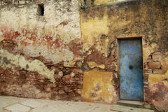 Grunge background. Old damaged wall and door stock photo