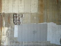 Grunge Background 2. Description: A cement wall in various shades of grey and brown with a steel grate showing through a broken section of the wall, which is Stock Photo