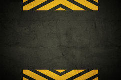 Grunge background. Grunge backgroung, detail of asphalt or wall with yellow stripes Stock Photo