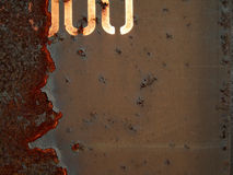 Grunge Background. Rusty brown grunge background with stencil Stock Images