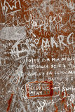 Grunge Background. With graffiti and writings on a rusty metallic surface Stock Photo