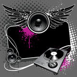 Grunge background. Speaker with wings and turntable on modern grunge background Royalty Free Stock Photography