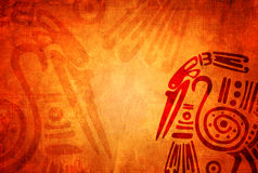 Grunge background with American Indian traditional patterns. Background with grunge paper texture of orange color and American Indian traditional patterns with Stock Photos