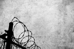 Grunge background with barbed wire fence Royalty Free Stock Photos