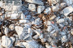 Grunge background from beton stones and rusty wire. Close up Royalty Free Stock Photo