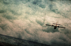 Grunge  background. Clouds,sky, sea and airplane Royalty Free Stock Photography