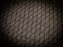 Shadow from mesh fencing on asphalt with dark frame stock image