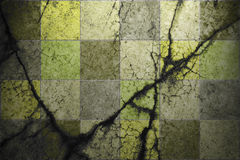 Grunge background of cracked tiles Royalty Free Stock Photo