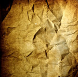Grunge background - crumpled vintage old paper. Grunge sepia background - crumpled vintage old burnt paper royalty free stock photos