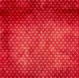 Grunge background with dots pattern. And paper texture of red color. Backdrop can be used for wallpaper, pattern fills, web page background, surface textures royalty free stock photo