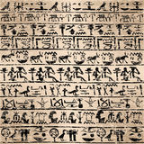 Grunge background with Egyptian hieroglyphs Stock Photos