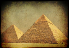 Grunge background with Egyptian pyramids Stock Images