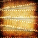 Grunge background with film. The grunge background with film Royalty Free Stock Images