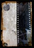 Grunge background with film strip. Mixed media illustration of blank grunge paper with film strip Royalty Free Stock Photo
