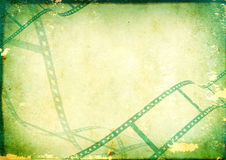 Grunge background with filmstrip Royalty Free Stock Images